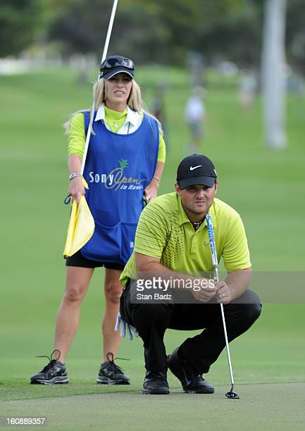 Patrick Reed watches play on the 18th green during the first round of the Sony Open in Hawaii at Waialae Country Club on January 10 2013 in Honolulu...