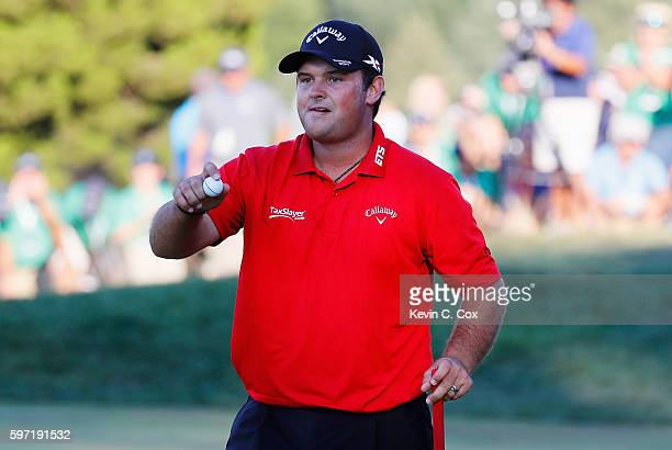 Patrick Reed waves to the gallery on the 18th green after winning The Barclays in the PGA Tour FedExCup PlayOffs on the Black Course at Bethpage...