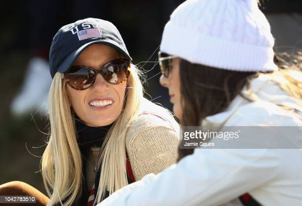 Patrick Reed's wife Justine Reed chats during the morning fourball matches of the 2018 Ryder Cup at Le Golf National on September 29 2018 in Paris...