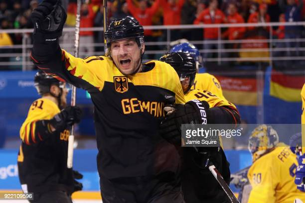 Patrick Reimer of Germany reacts after scoring the game winning goal in overtime against Sweden to win 43 during the Men's Playoffs Quarterfinals...