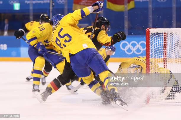 Patrick Reimer of Germany scores a goal against Viktor Fasth of Sweden in overtime to win 43 during the Men's Playoffs Quarterfinals game on day...