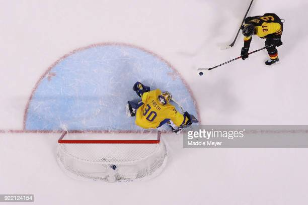 Patrick Reimer of Germany scores a goal on Viktor Fasth of Sweden in overtime to win 43 during the Men's Playoffs Quarterfinals game on day twelve of...