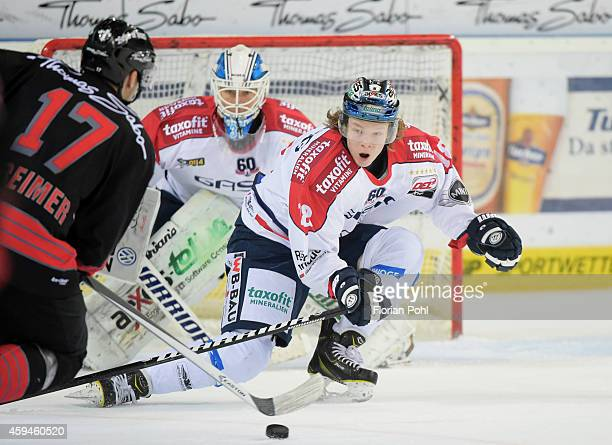 Patrick Reimer of the Thomas Sabo Ice Tigers Nuernberg and Jonas Mueller of the Eisbaeren Berlin in action during the game between Thomas Sabo Ice...