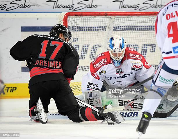 Patrick Reimer of Thomas Sabo Ice Tigers Nuernberg und Petri Vehanen of Eisbaeren Berlin duel during the game between Thomas Sabo Ice Tigers and...