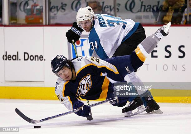Patrick Rissmiller of the San Jose Sharks trips up Jordin Tootoo of the Nashville Predators on the face-off during their 2007 Western Conference...
