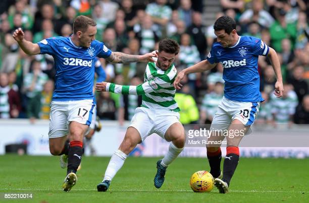 Patrick Roberts of Celtic attempts to get past Graham Dorrans of Rangers and Lee Hodson of Rangers during the Ladbrokes Scottish Premiership match...