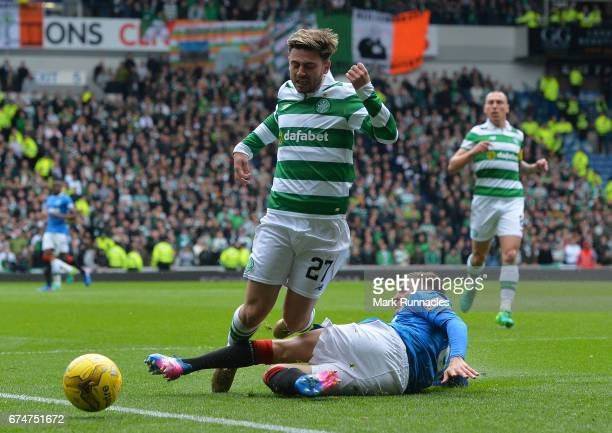 Patrick Roberts of Celtic is brought down by Myles Beerman of Rangers leading to a penalty during the Ladbrokes Scottish Premiership match between...