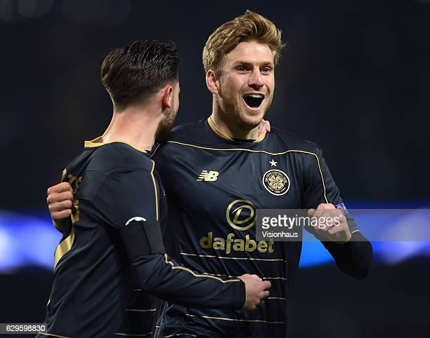 Patrick Roberts of Celtic is congratulated by team mate Stuart Armstrong after scoring during the UEFA Champions League match between Manchester City...