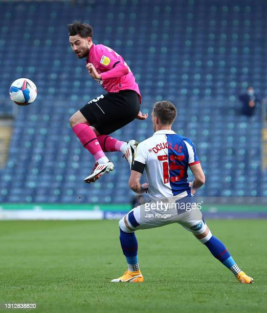 Patrick Roberts of Derby County heads the ball watched by Barry Douglas of Blackburn Rovers during the Sky Bet Championship match between Blackburn...