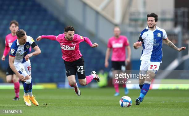 Patrick Roberts of Derby County is fouled by Barry Douglas of Blackburn Rovers during the Sky Bet Championship match between Blackburn Rovers and...
