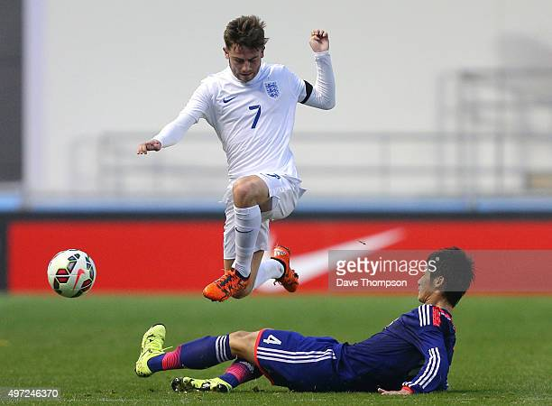 Patrick Roberts of England is tackled by Reiya Morishita of Japan during the U19 International friendly match between England and Japan at Manchester...