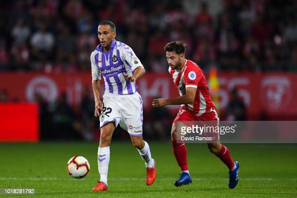 Patrick Roberts of Girona FC competes for the ball with Nacho of Real Valladolid CF during the La Liga match between Girona FC and Real Valladolid CF...