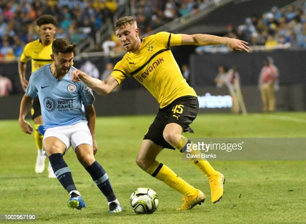 Patrick Roberts of Manchester City and Soren Dieckmann of Borussia Dortmund go for the ball on July 20 2018 at Soldier Field in Chicago Illinois...