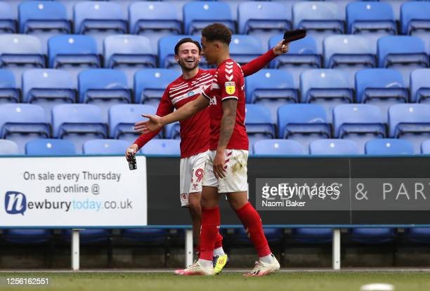 Patrick Roberts of Middlesbrough and team mate Marcus Tavernier leave the pitch after the Sky Bet Championship match between Reading and...