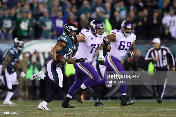 Patrick Robinson of the Philadelphia Eagles returns an interception for a touchdown during the first quarter past Riley Reiff and Rashod Hill of the...