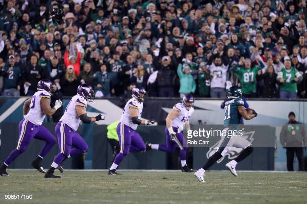 Patrick Robinson of the Philadelphia Eagles returns an interception for a touchdown during the first quarter against the Minnesota Vikings in the NFC...