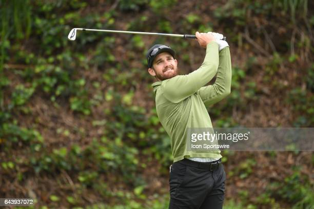 Patrick Rodgers hits from the sixth hole tee during the third round of the Genesis Open golf tournament at the Riviera Country Club on February 19...