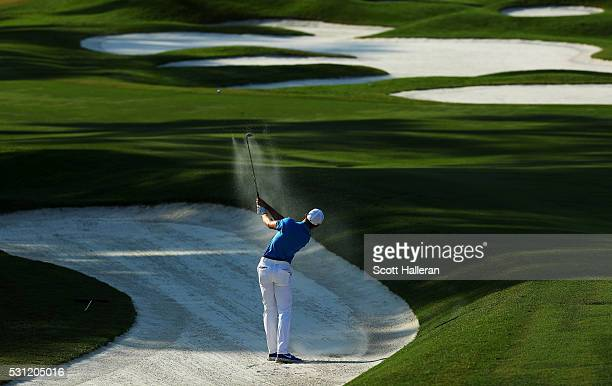 Patrick Rodgers of the United States plays a shot from a bunker on the fifth hole during the second round of THE PLAYERS Championship at the Stadium...