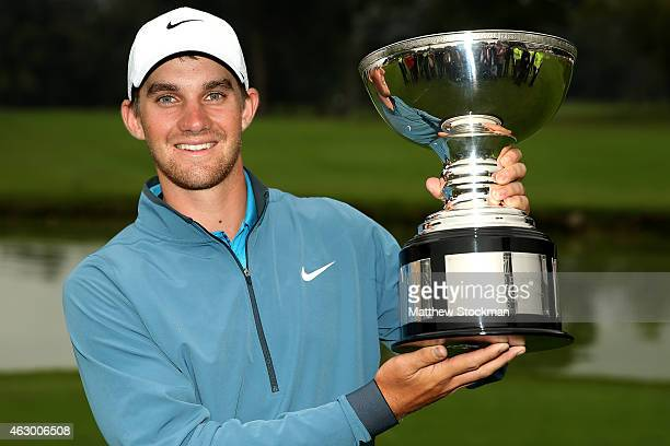 Patrick Rodgers of the United States poses for photographers after winning the Colombia Championship presented by Claro at the Country Club de Bogoto...