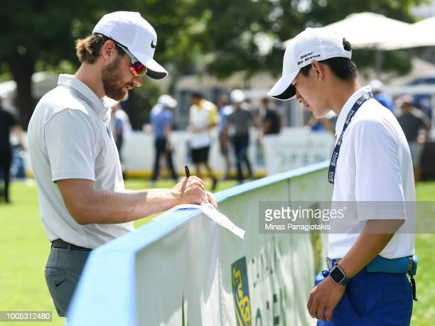 Patrick Rodgers signs an autograph during the practice rounds at the RBC Canadian Open at Glen Abbey Golf Club on July 25 2018 in Oakville Canada