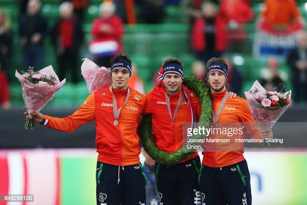 Patrick Roest Sven Kramer and Jan Blokhuijsen of Netherlands pose in the Men's Overall Classification medal ceremony during day two of the World...