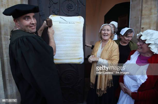 Patrick Rogers and other members of the Unitarian Church, St Stephen's Green, Dublin, during a re-enactment of Martin Luther nailing up his historic...