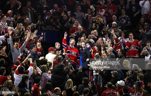 Patrick Roy enters through the crowd during a ceremony to retire his before the Boston Bruins face the Montreal Canadiens during their NHL game at...
