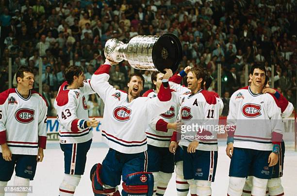 Patrick Roy of the Montreal Canadiens celebrates with the Stanley Cup after the Canadiens won Game 5 of the 1993 Stanley Cup Final over the Los...