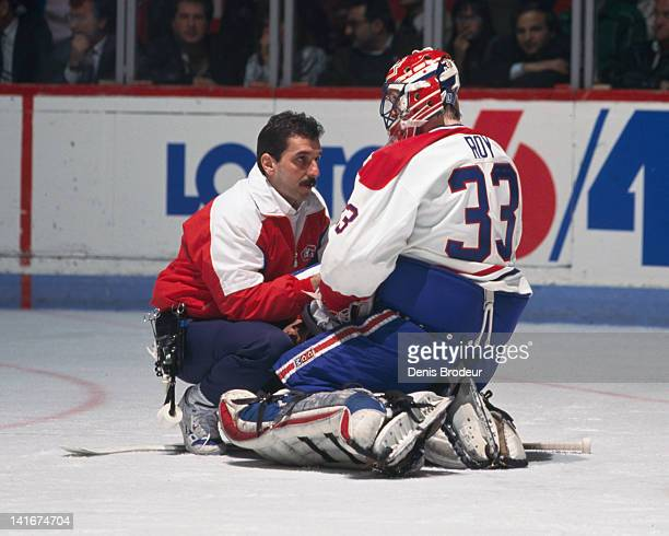 Patrick Roy of the Montreal Canadiens is attended to by a trainer after getting injured during a game Circa 1990 at the Montreal Forum in Montreal...