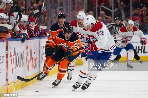 Patrick Russell of the Edmonton Oilers moves the puck past Mike Reilly of the Montreal Canadiens at Rogers Place on December 21 in Edmonton Canada