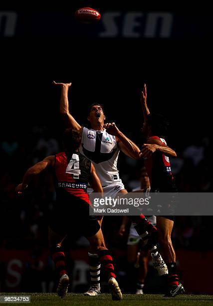 Patrick Ryder of the Bombers contests a centre bounce with Aaron Sandilands of the Dockers during the round two AFL match between the Essendon...