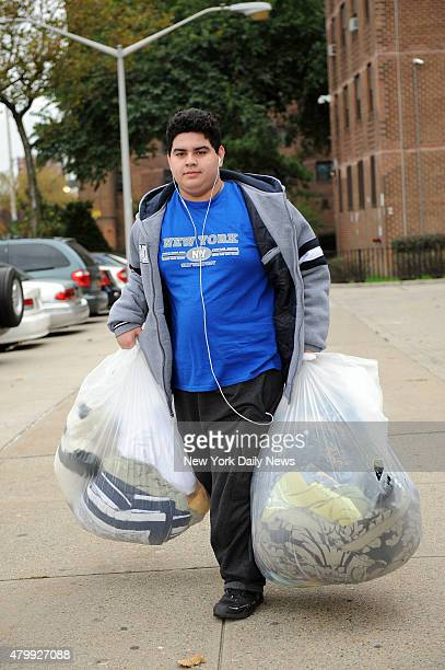 Patrick Salazar prepares to evacuate from Coney Island Houses with his family after Gov Cuomo order evacuation ahead of Hurricane Sandy Oct 28 2012