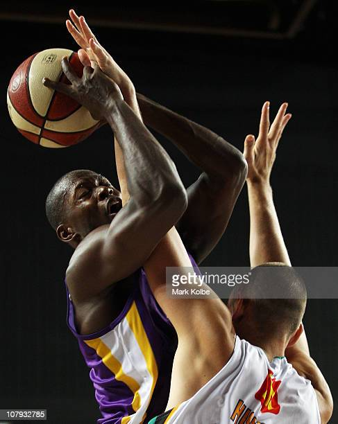 Patrick Sanders of the Kings is fouled as he drives to the basket during the round 13 NBL match between the Sydney Kings and the Townsville...