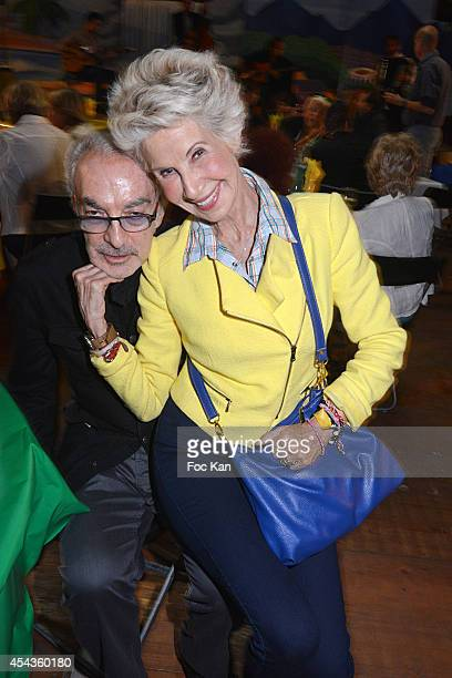 Patrick Scemama and Danielle Gilbert attend the 'Fete A Neu Neu' At Porte De La Muette on August 29 2014 in Paris France
