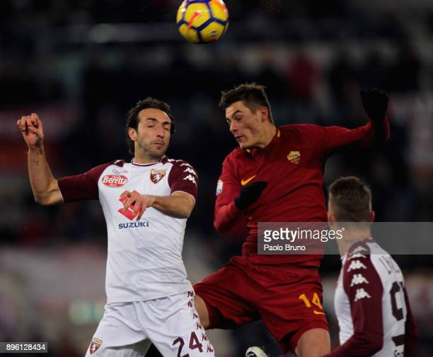 Patrick Schick of AS Roma competes for the ball with Emiliano Moretti of Torino FC during the TIM Cup match between AS Roma and Torino FC at Olimpico...