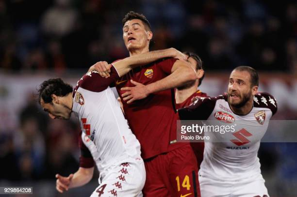 Patrick Schick of AS Roma competes for the ball with Emiliano Moretti and Alessandro De Silvestri of Torino FC during the Serie A match between AS...