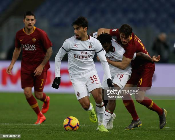 Patrick Schick of AS Roma competes for the ball with Franck Kessie and Lucas Paqueta of AC Milan during the Serie A match between AS Roma and AC...