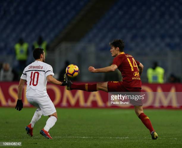 Patrick Schick of AS Roma competes for the ball with Hakan Calhanoglu of AC Milan during the Serie A match between AS Roma and AC Milan at Stadio...