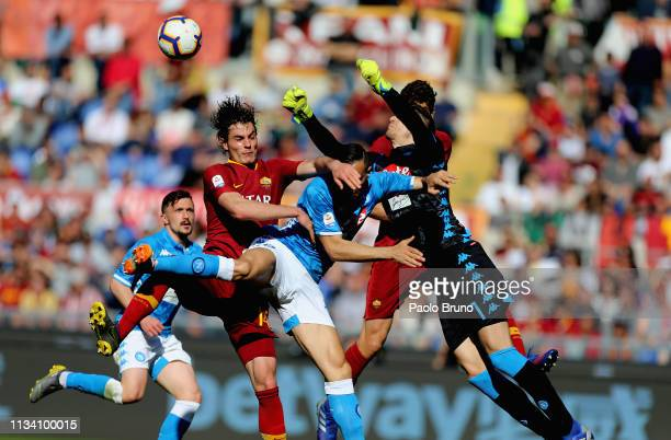 Patrick Schick of AS Roma competes for the ball with Nikola Maksimovic and Alex Meret of SSC Napoli during the Serie A match between AS Roma and SSC...