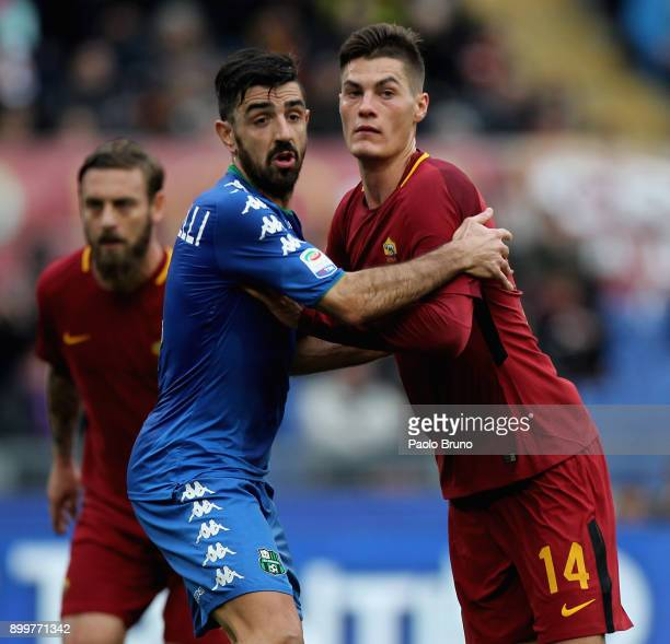 Patrick Schick of AS Roma competes with Francesco Magnanelli of US Sassuolo during the serie A match between AS Roma and US Sassuolo at Stadio...