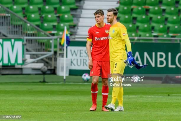 Patrick Schick of Bayer 04 Leverkusen and goalkeeper Jiri Pavlenka of SV Werder Bremen look on during the Bundesliga match between SV Werder Bremen...