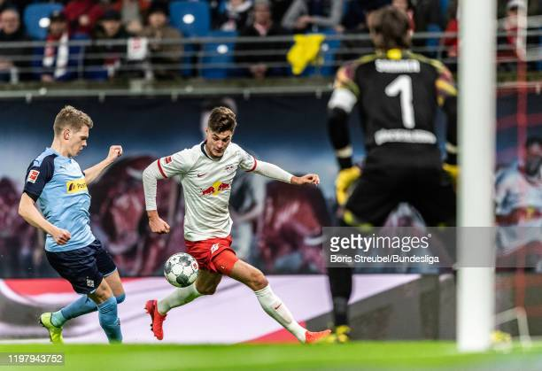 Patrick Schick of RB Leipzig in action with Matthias Ginter of Borussia Mönchengladbach during the Bundesliga match between RB Leipzig and Borussia...