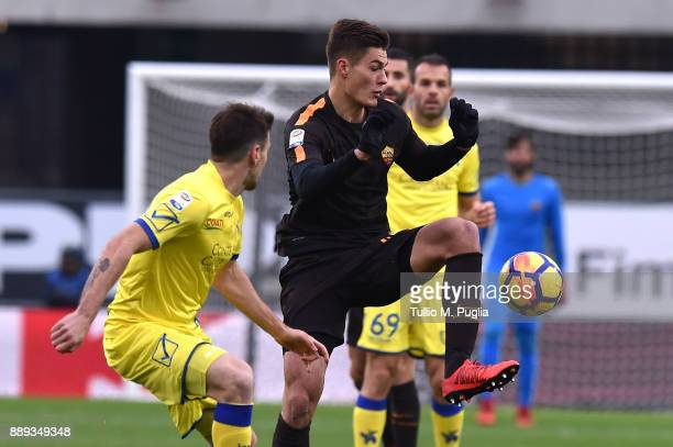Patrick Schick of Roma controls the ball as Nenan Tomovic of Chievo Verona tackles during the Serie A match between AC Chievo Verona and AS Roma at...