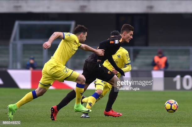 Patrick Schick of Roma holds off the challenge from Nenan Tomovic of Chievo Verona during the Serie A match between AC Chievo Verona and AS Roma at...