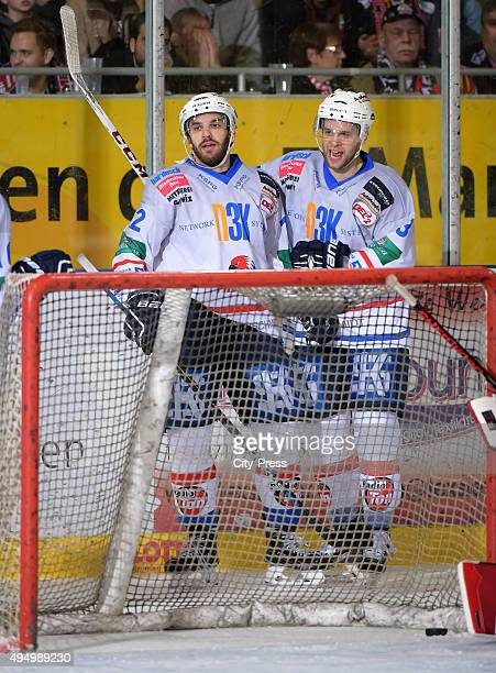 Patrick Schmid and Brad Schell of the Heilbronner Falken celebrate after scoring the 32 during the game between the Pinguins Bremerhaven and the...