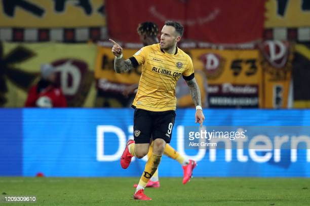 Patrick Schmidt of Dresden celebrates his team's first goal during the Second Bundesliga match between SSV Jahn Regensburg and SG Dynamo Dresden at...