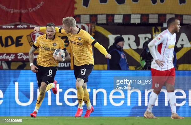 Patrick Schmidt of Dresden celebrates his team's first goal with team mates Simon Makienok during the Second Bundesliga match between SSV Jahn...