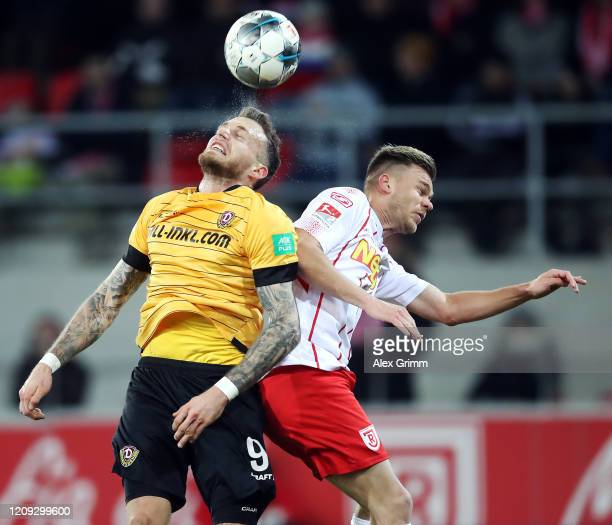 Patrick Schmidt of Dresden jumps for a header with Benedikt Saller of Regensburg during the Second Bundesliga match between SSV Jahn Regensburg and...
