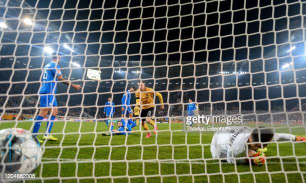 Patrick Schmidt of Dresden scores his team's second goal past goalkeeper Marcel Schuhen of Darmstadt during the Second Bundesliga match between SG...