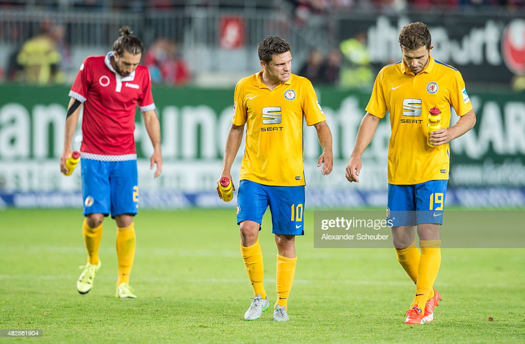 Patrick Schoenfeld (Eintracht Braunschweig), Mirko Boland (Eintracht Braunschweig) and Ken Reichel (Eintracht Braunschweig) are disappointed during the 2. Bundesliga match between 1. FC Kaiserslautern and Eintracht Braunschweig at Fritz-Walter-Stadion on July 31, 2015 in Kaiserslautern, Germany.
